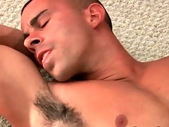 Muscular hottie masturbates chunky cock and cums