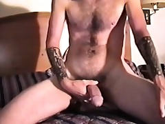 Enticing unpaid lay out reveals his tight ass and strokes his long dick